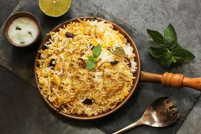 Mutton biriyani,raita and dessert image