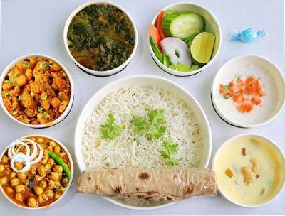 Chana masala,palak chicken,chapathi,rice,salad image