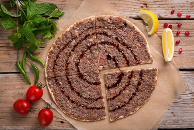 Minced Meat and Pomegranate Man'oushe image