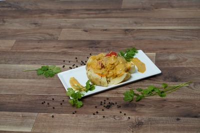 Baked Potato with chicken Korma image