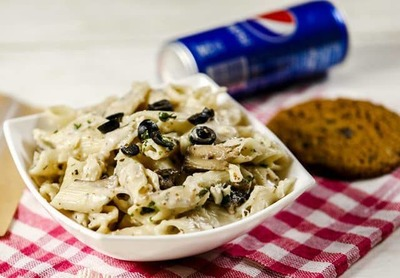 White Sauce Pasta with Pepsi and Cookie image